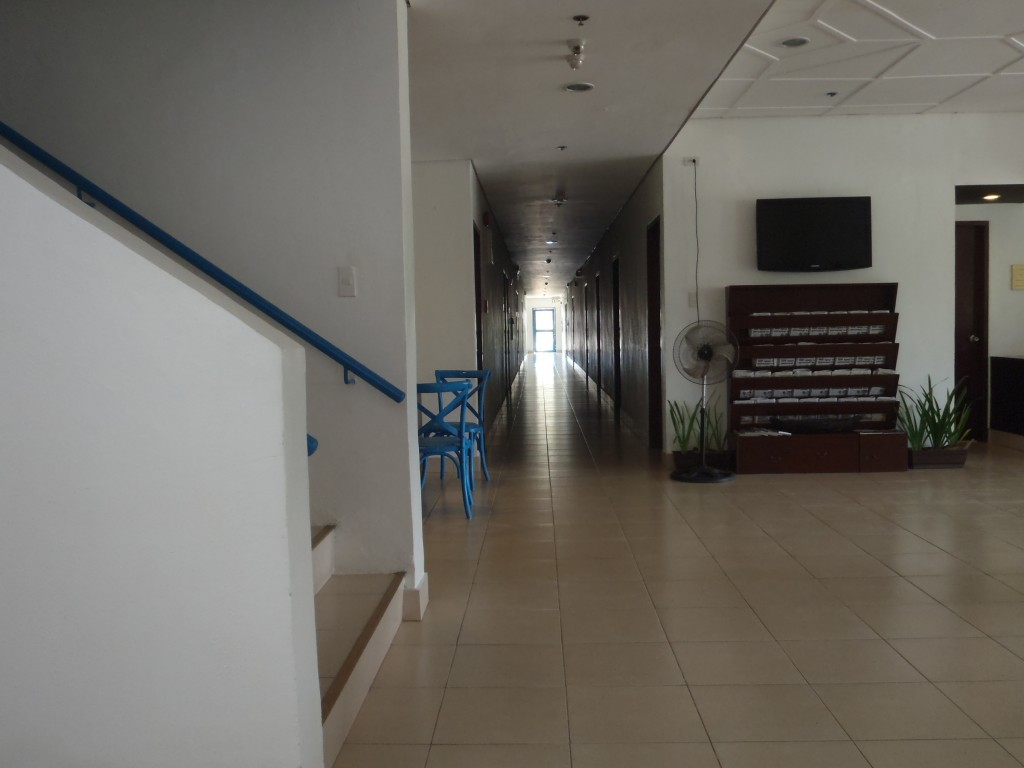 This is the right hallway on the first floor. To the right of the TV is the front desk.